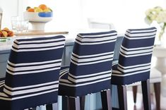 Lee Industries counter stools upholstered in Sunbrella fabric stand up to afternoon snacks and everyday dining with ease.
