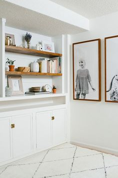 The 'overexposed' portraits on the wall are a great use of negative space in an artwork and make family portraits more unique.