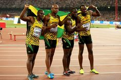 Usain Bolt with Nickel Ashmeade, Asafa Powell and Nesta Carter of Jamaica celebrate after winning gold in the Men's 4x100 Metres Relay final during day eight of the 15th IAAF World Athletics Championships in Beijing, China on August 29th, 2015. Patrick Smith/Getty