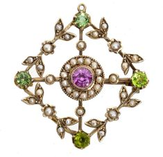 A GEM SET GOLD OPENWORK BROOCH-PENDANT, C1905  36,mm, unmarked, 6g  Sold @ Mellors & Kirk