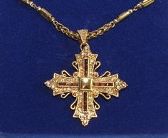 Jackie Kennedy Necklace - GP Maltese Cross Pin Pendant - #jackiekennedyjewelry  This is a stunning replica by Camrose & Kross of a Maltese cross necklace owned by Former First Lady Jacqueline Kennedy. It is done in a gold tone finish and has lots of bright shiny amber-color stones. The removable pin/pendant measures 2 wide and 2-1/2 tall (including the bail). This cross comes in a velvet box with a Certificate of Authenticity. This cross necklace is perfect for work and any spec...