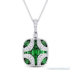The featured pendant is cast in 18k white gold and showcases a tapered rectangle design adorned with oval, princess, & marquise cut emeralds accentuated by round cut diamonds all the way up to the pendant's loop.