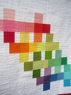 solids charm pack quilt - I think this might be one, but a little different with some printed fabric and some solid in black, white and red.