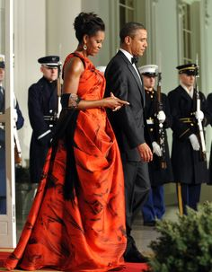 Michelle Obama looking fabulous. Note the black shawl giving the perfect finishing touch to her gown.