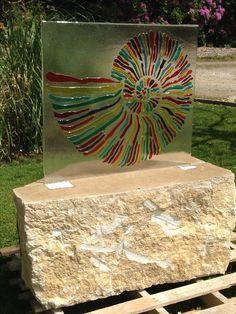 Fused glass ammonite set into Purbeck stone