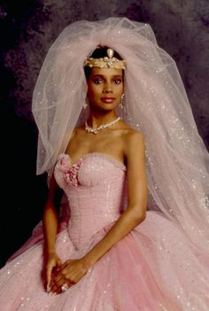 The pink confection Lisa McDowell (Shari Headley) wears to wed Prince Akeem Joffer of Zamunda is hard to miss. Movie Wedding Dresses, Wedding Movies, Wedding Veils, Kimberly Williams, Ginger Rogers, Tulle Ball Gown, Ball Gowns, Gossip Girl, Formal Gowns