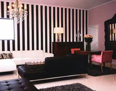 Wide black and white stripes add drama to this room.