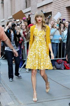 BYLINE: EROTEME.CO.UK.Taylor Swift looks golden in her yellow dress and sweater as she leaves the Katie Couric Show. (October 22, 2012 - Source: Disciullo/Bauer Griffin)