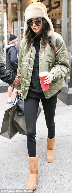 Comfort comes first: As well as her hat, Kendall wore her new shoes as she left the store...