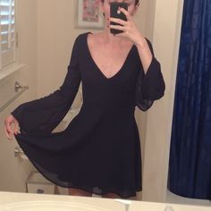 Long sleeve navy blue open back dress  NWT A short dress with Long wide sleeves Tobi Dresses Mini
