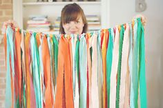 Fabric/ribbon garland. Great for photo-booth backdrops.
