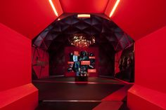 Using hexagonal shape and bright red colour to create an immersive atmosphere in a dome.    NIKE TRACK LAB by Jeffrey Docherty, via Behance