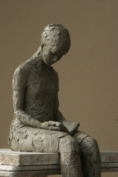 Reading Figure by Carol Peace. Photographed here in  clay 44 cms bottom of toe to head Edition of 9 in Bronze