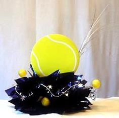 A few tennis center piece more can be found on this site. Use a tennis trophy at stick some balls on different size sticks.
