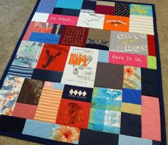 T Shirt Quilt - Jelly Bean Quilts - This one incorporates t-shirts, pajama pants, & a few other pieces of clothing!