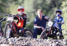 Prince Harry poses with trails bike riders during a visit to an outdoor centre on June 29, 2014 in Antaeaya, Chile.