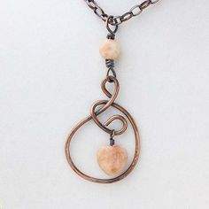 You will want to wear this rustic copper necklace everyday. The gentle curves of Zannas asymmetrical loop and circle overlap for a stunning look. The