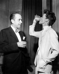 "Humphrey Bogart & Katharine Hepburn at a press reception at Claridges (London 1951, via popperfoto)    ""That woman is sensational. I'll tell you frankly, she used to irritate the bejeepers out of me with all that 'mahvelous' talk. But when I got to know her I found out she's one helluva dame.""    -Bogart on Hepburn"