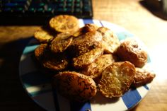 Oven baked red potato chips seasoned with cumin seeds, curry powder and paprika.