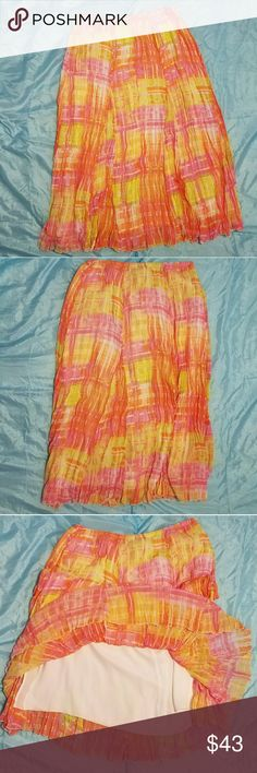 "🌞SALE SALE 🌻LADIES SPRING/SUMMER SKIRT Beautiful bright maxi skirt with slip layer. (Pic3)  Very comfortable with an elastic waist and perfect for Spring & Summer!! Dress up with a dressy tank top, shrug sweater & heels. Dress down with basic tank or t-shirt & flip flops!! EUC in that it looks brand new! Only worn a couple times.  Waist: 16""      Length:  33""  Questions & reasonable offers always welcome  Smoke & pet free home  Bundle discount is 20% off  3+ listings  Thanks for stopping…"