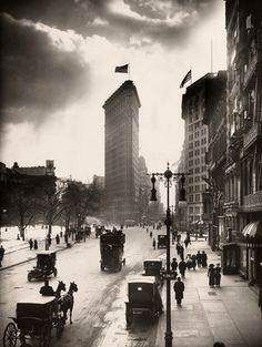 Locals walk the streets of Madison Square near the Flatiron Building in New York City, 1918.