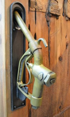 old gas nozzle as door handle ... love for the mancave or entry into garage.
