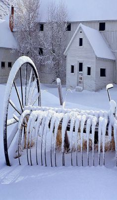 White Barn With Snow On Old Hay Rake