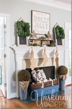 Christmas mantel with boxwood wreaths by Unskinny Boppy