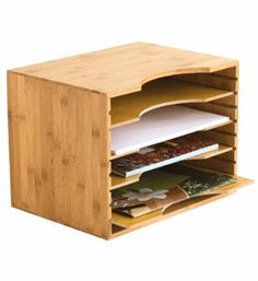 Bamboo File Organizer. desktop file organizer constructed of durable eco-friendly bamboo. four adjustable slide-out shelves which accommodate 8 1/2inch x 11inch paper and file folders $35