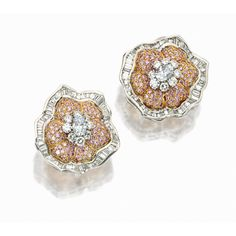 PAIR OF PINK DIAMOND AND DIAMOND 'FLORAL' EAR CLIPS, GRAFF. Each flower head set in the centre with a cluster of oval and brilliant-cut diamonds, surrounded by domed petals pavé-set with circular-cut pink diamonds, within a swirled frame channel-set with tapered baguette diamonds, the diamonds and pink diamonds altogether weighing approximately 8.40 and 3.45 carats respectively, mounted in 18 karat white and yellow gold.