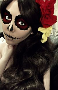 "ok this is cool halloween makeup. it reminds me of ""día de los muertos"" (day of the dead)"