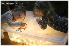 DIY Light Box for Sensory Play - The Imagination Tree DIY Light Box Activity for Sensory Play Using Christmas Lights Sensory Rooms, Autism Sensory, Sensory Table, Sensory Bins, Sensory Activities, Infant Activities, Activities For Kids, Motor Activities, Diy Sensory Toys