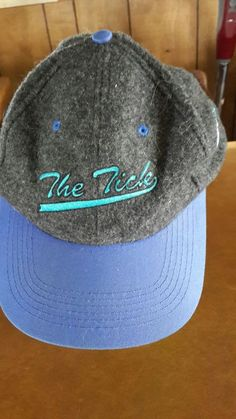 8f2fa2ed108 The Tick Wool Snapback Hat The Planet Inc Gray With Blue Bill and Details   ThePlanetInc