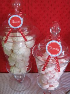 Merengue cookies, heart shaped marshmallows, apothecary jars