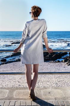 Linen Shirt Dress. Borrowed from the boys and modified into the ultimate feminine creation. For functionality we added inseam pockets and adorned the neckline with some charming buttons. The dress has three quarter sleeves you can roll up in the summer or wear down on those colder days paired up with tights. Linen clothing. Natural fiber. Casual wear. Camps Bay. Cape Town. Fashion Gem. Natural high. All a girl wants. Timeless Classic. Three quarter sleeve. Wooden Buttons.Ocean view. Linen Shirt Dress, Cold Day, Timeless Classic, Out Of Style, Quarter Sleeve, Cape Town, Clothing Items, Casual Wear, Going Out