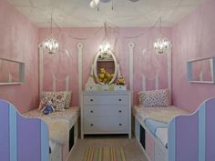This modern fairytale room was designed to make two little girls feel like princesses, while providing ample storage for their clothes and toys. The mirror was the inspiration for the custom MDF headboards, which feature head to toe strips to create depth.