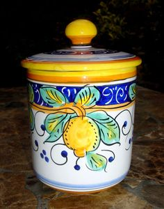 "This little Italian ceramic canister is a beautiful way to store salt or sugar. Hand painted in Umbria.    Size: 4.5"" tall to top of lid, 4"" diameter     Our Limone Alcantara Italian Ceramic Collection is hand-painted for us by a family-owned pottery studio near Deruta, Italy. The villages surrounding Deruta have a rich heritage in Italian Majolica production dating back hundreds of years and Limone Alcantara is one of the our most popular designs."