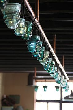 Old glass electric pole insulators used as lights, at The Grange in Providence, RI