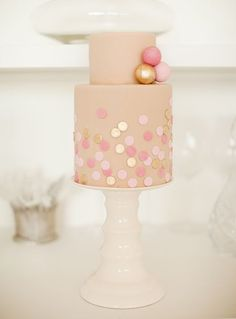Mini cakes are our fave! Well, anything mini is our fave! Love the pink and gold combo, the polka dots and the accents balls on the top tier!