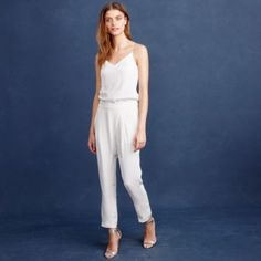 """Who says you have to wear a gown to your own wedding? We've never met a jumpsuit we didn't like, and this one is no exception. Finished with a delicate camisole-inspired top and a unique crossover closure at the waist, it's perfect for your big day—or to change into at the reception—and every special occasion thereafter. <ul><li>24 1/2"""" inseam.</li><li>Silk.</li><li>Back zip.</li><li>Slant pockets.</li><li>Lined.</li><li>Dry clean.</li><li>Import.</li><li>Online only.</li></ul>"""