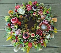 Resendiz Brothers Protea Growers LLC was etablished in 1999 with a passion for growing exotic South African and Australian flowers. Wreaths And Garlands, Xmas Wreaths, Christmas Decorations, Flower Cart, Flower Boxes, Funeral Arrangements, Flower Arrangements, Australian Christmas, Australian Flowers
