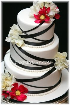ribbon and cake (im not sure i would want the flowers on there though)