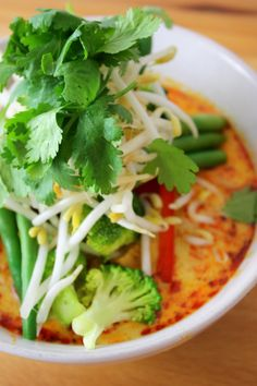 Vegan Laksa Added grated carrot, soy beans, broccoli, beans, sweet pot, Harissa, chilli, sprouts and corriander, puffed tofu