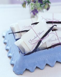 As a party favor, blocks of white chocolate were wrapped in parchment, tied with waxed twine, and topped with a vanilla bean to make individual servings of Chocolat Blanc.