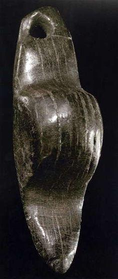 Petersfels Venus, made of jet. This is the most well known of the Petersfels Venus figures.Ca 15 000 BP