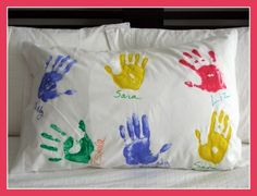 END OF YEAR GIFT  Get inexpensive pillowcases and paint-print the children's hands (or have kids write their names w/ sharpie) on each pillowcase.  Then write this poem on each.  Now I lay me down to sleep   I'll count these hands (names) instead of sheep   And think about the friends I've gotten   Since my first day of (Mrs. _____'s) kindergarten.