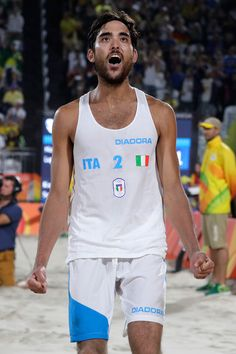 Daniele lupo Photos - Daniele Lupo of Italy playing with Paolo Nicolai of Italy celebrates winning the beach volleyball Men's Semi final against Viacheslav Krasilnikov and Konstantin Semenov of Russia on Day 11 of the Rio 2016 Olympic Games at the Beach Volleyball Arena on August 16, 2016 in Rio de Janeiro, Brazil. - Beach Volleyball - Olympics: Day 11
