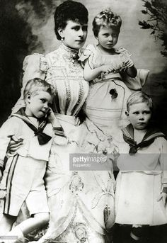 The Duchess of York (1867-1953) who was to become Queen Mary the Queen Consort of King George V, pictured with her children left-right, Prince Edward, Princess Mary and Prince Albert,circa 1900,