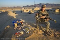 """""""Curtis Newcomer, a U.S. Army soldier, with his typical day's worth of food at the National Training Center at Fort Irwin in California's Mo..."""
