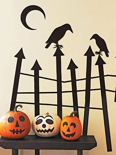 On the Fence  Dream up a haunted corner in your house with a rickety wrought-iron fence for goblins and spooky crows.